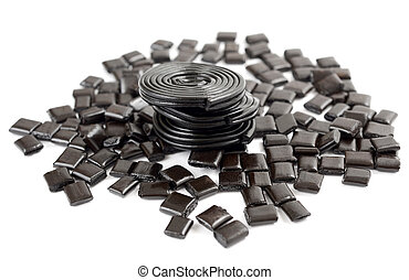 licorice candy and licorice wheels isolated on white
