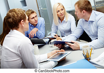 Planning work - Image of group of employees discussing new...