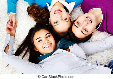 Friends on the floor - Above angle of attractive friends...
