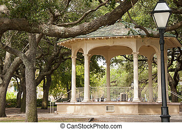 Gazebo in the Park - A large gazebo and street light in a...