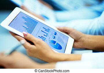 Market analysis - Businesswoman hands with touchpad while...