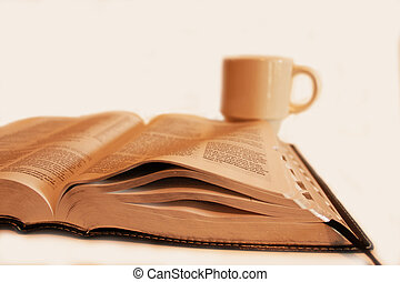 Morning Routine - Bible and coffee cup isolated on a white...