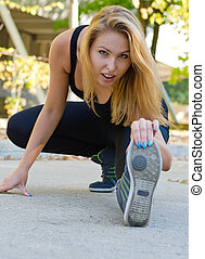 Attractive blonde girl working out - Closeup of an...