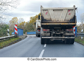 dangerous situation with two trucks on close bridge