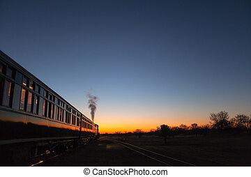 Train into sunset - Vintage train going off into the sunset