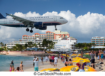Airplane lands at Princess Juliana airport - PRINCESS...
