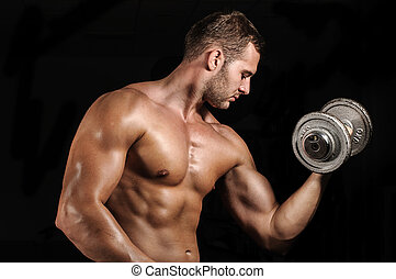 Gym training workout - Young man working out in gym