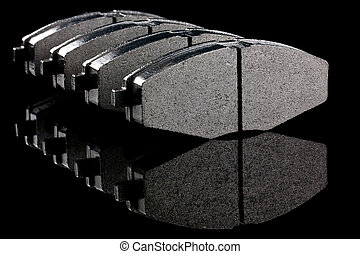 brake shoe - A set of four new automobile brake pads on a...