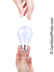 Hand with bulb isolated on white background
