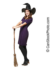 The young beautiful witch with a broom and hat - The young...
