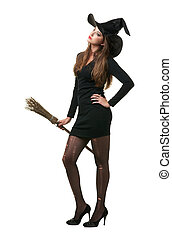 pretty sexy young brunette witch with a broom, isolated...