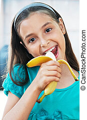 cute girl eats an banana - cute caucasian girl eats an...