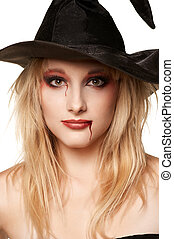Beautiful blonde in a witches hat - a Beautiful blonde girl...