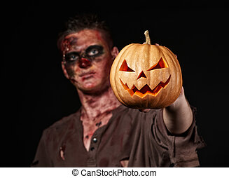 The boy is zombie - The boy is scary zombie with pumpkin