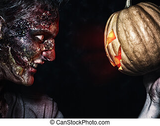 The boy is zombie with pumpkin - The boy is scary zombie...