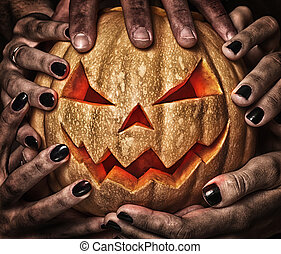 evil pumpkin with glowing eyes that are holding