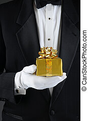 Man in Tuxedo Holding Christmas Gift - Closeup of a man...