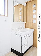 Washstand in bathroom of new residential housing