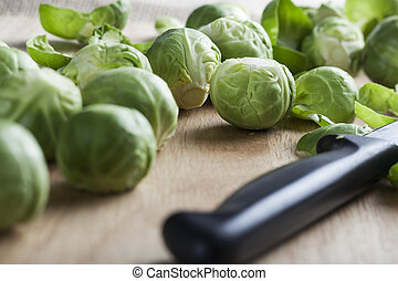 Brussel Sprouts - Burssel sprouts on cutting board with a...