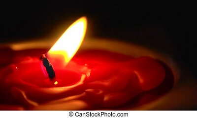 wind blows candle flame right - Closeup of a candle flame...