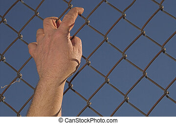 Escape - A person attempting an escape over a chain link...
