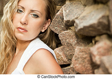 Young sexy woman on wall background