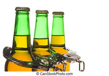 Beer and Handcuffs - Drunk Driving Concept - Drunk driving...