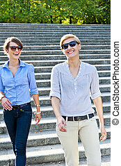 Two beautiful woman with sunglasses on park - Two beautiful...