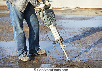 construction road worker with perforator - Builder worker...