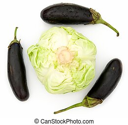 cabbage and eggplants - heads of cabbage and three eggplants...