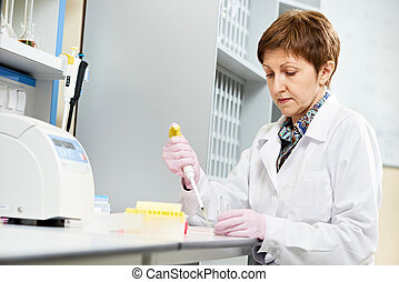 scientist with Dropper at laboratory - Researcher with...
