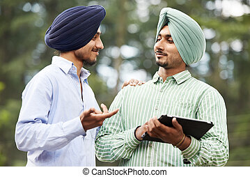Young adult indian sikh men - Two smiling authentic native...