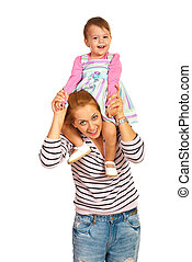 Mother giving piggy back to girl - Mother giving piggy back...