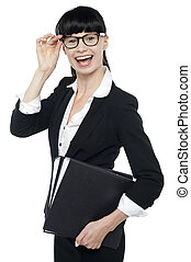Cheerful female secretary carrying business files