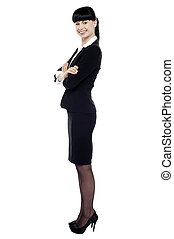 Cheerful confident business lady posing with arms crossed
