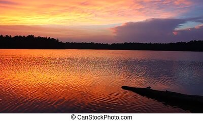 Classic Northwoods Sunset - Brilliant colors of sunset over...