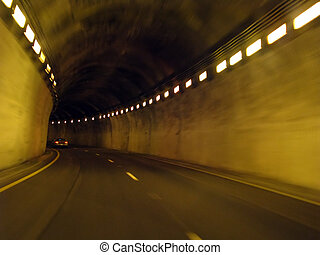 tunnel - traveling in a long underground lighted tunnel