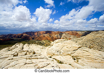 Looking down the Sandstones in to Snow Canyon - Utah - Snow...