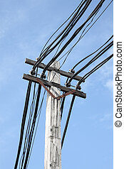 Electric cable on pole in blue sky.