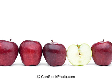 Red delicious apples with an individual eaten green apple