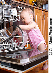 baby at dishwasher in kitchen