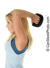 Staying Fit - Beautiful blonde woman exercising with...