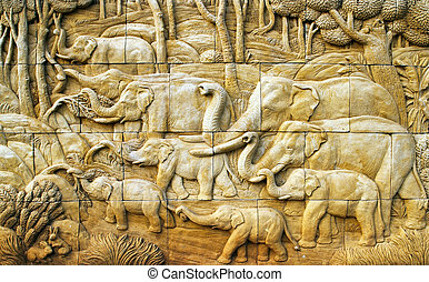 carved Elephant on stone wall