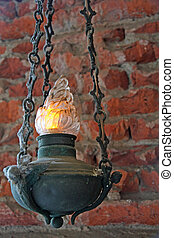 hanging votive antique lamp with brick wall