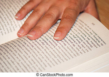hand on book - hand of woman keeps a book