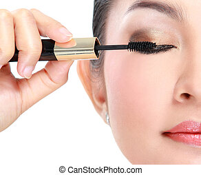 Woman with mascara - Beautiful woman applying mascara on her...