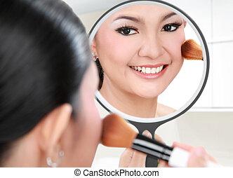 beautiful woman doing make up - Reflection of beautiful...