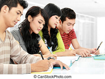 Group of students studying together in the classroom