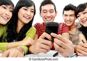 students with cellphone - Group of students smiling looking...