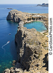 Greek Island Coastline - A blue lagoon near the town of...